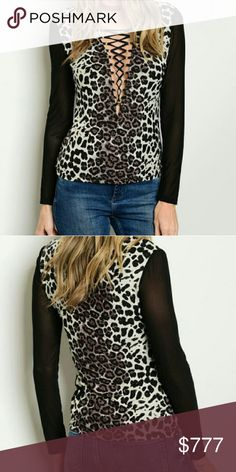"""Animal print lace up front top Brand new with tags Boutique item, price is firm   Bring out your wildside with this sexy animal print top featuring, plunging criss cross neckline, sheer black sleeves and silver glitter detailing. Pair with your favorite jeans and heels/boots.  Small Bust 15""""across/Length23"""" Medium Bust 16"""" across/Length 23"""" Large Bust 17""""across/Length 24"""" Model:modeling the size small Material 95%nylon 5%spandex/light weight Tops"""