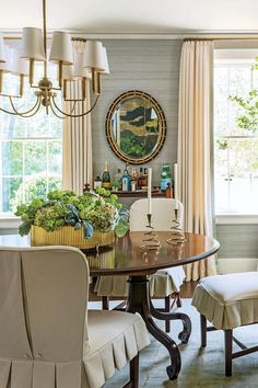 Create a Calming Palette - 79 Stylish Dining Room Ideas - Southernliving. Walls covered in subtle blue grass cloth create a serene space that's inviting and warm.    See more of this classic Birmingham home.