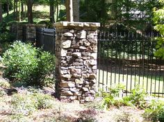 Wrought iron with stone columns. I might do something along these lines in front.