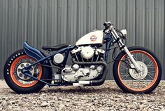 This is a sweet bobber with a great logo of Gulf Oil on it. Check out the work on the exhaust on this bobber motorcycle..
