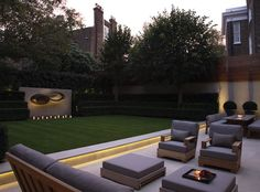 Sculpture and lighting are an integral part of this London garden by Luciano Giubbilei