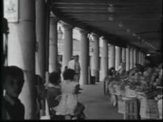 Montage of film of Canal Street and the French Quarter in the 1930s