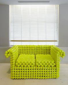 A traditional Chesterfield sofa commissioned by Nike as the seasonal creative addition to their London Brand Space. Made from 1,981 individual tennis balls & constructed using 3 techniques to define the different sections. (www.demelzahill.com)