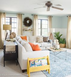 Fall decorating ideas - Fall Home Tour - Four Generations One Roof / {sponsored}  A Fall living room full of HomeGoods home decor creates a casual yet elegant living space for a family of four generations living under one roof. Touch of brown and orange help create an autumn cozy space.