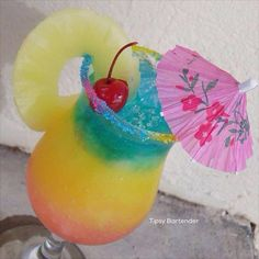 Caribbean Carnival Cocktail - For more delicious recipes and drinks, visit us here: www.tipsybartender.com