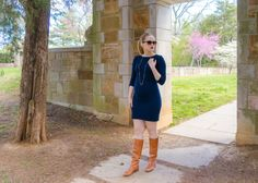 Catherine Short in her navy blue maternity dress & brown boots
