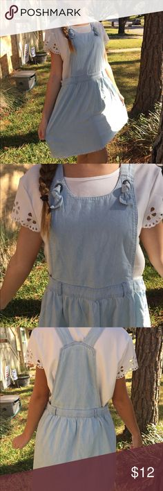 This overall looking dress This dress is not denim but feels like cotton. It is hey soft and comfortable on. It is a child's XL but I usually wear an adult M and it fit fine. I wore this dress 2 or 3 times but it is still like new. Cat and Jack Dresses Casual