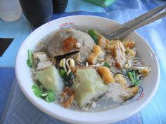 Our recipe of the week is from the Indonesia. Try your hand at cooking Bakso (Beef meatballs). This is cooking at the easy level. #Bakso #Indonesia #Recipe For more info: http://thedomesticman.com/2014/04/05/bakso-indonesian-beef-balls/ Photo credit: wikimedia commons