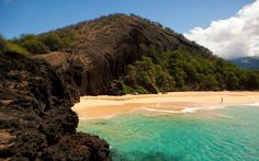"""Nearly two-thirds of a mile long and 100 feet wide, Makena, also called """"Big Beach,"""" in Maui, is beloved by both locals and tourists. Tote along towels and sunscreen, park it on the sand, and enjoy impressive views of the tiny island of Molokini. And don't worry, we've got lunch picked out for you: Jawz Fish Tacos, two of Maui's most popular food trucks, park on the side of the road near Makena, and are open daily from 10 a.m. to 5 p.m. Chow down on fresh mahi mahi,"""