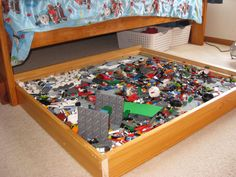 Lego trundle for under the bed. Keeps the Legos off the floor for easy clean up.