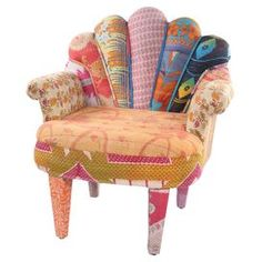 """One-of-a-kind peacock chair with a mango wood frame. Upholstered with reclaimed Kantha throws.   Product: ChairConstruction Material: Mango wood and vintage Kantha fabricColor: MultiFeatures: One-of-a-kindDimensions: 33"""" H x 29"""" W x 20"""" DNote: Due to the vintage nature of this product, some wear and tear is to be expected. Products may show signs of brand marks, scrapes or other blemishes.Cleaning and Care: Spot clean"""