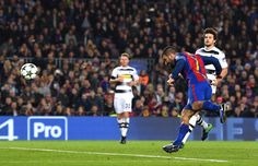 Arda Turan of Barcelona (R) scores his sides second goal during the UEFA Champions League Group C match between FC Barcelona and VfL Borussia Moenchengladbach at Camp Nou on December 6, 2016 in Barcelona.