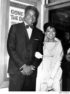 "**FILE**Ossie Davis and wife, Ruby Dee pose in front of their movie poster at the opening night gala of their film ""Gone Are the Days!"" in New York on Sept. 23, 1963. The movie, starring the married couple, is based on Davis's play ""Purlie Victorious."" Davis, the actor distinguished for roles dealing with racial injustice on stage, screen and in real life, has died, an aide said Friday. He was 87. Davis was found dead Friday, Feb. 4, 2005, in his hotel room in Miami, where he was making a…"