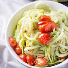 Simple and healthy, these zucchini noodles are paired with roasted tomatoes and a light white wine sauce. 310 calories per heaping serving