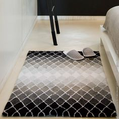 Reflex Bath Rug by Abyss & Habidecor creates an optical illusion with gradation. Offered in 2 colorways.