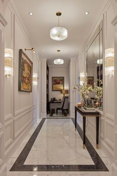 hallway flooring The main entrance hall has extravagant marble flooring and panelled walls with a library area at one end and an elegant power room skillfully hidden behind paneling off the hallway Home Room Design, Home Interior Design, Living Room Designs, House Design, Neoclassical Interior Design, Mansion Interior, Flur Design, Hall Design, Lobby Design