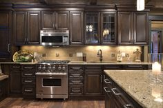 Love everything about this kitchen! Cabinet color, granited, wood floors                                                                                                                                                      More