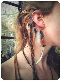 I love these ear cuffs! http://www.etsy.com/listing/84442649/ill-fly-away-a-tribal-feathered-ear-cuff