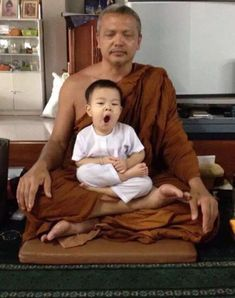 Yawning on Master's legs. The Little Monk Following in the Buddha's Footsteps http://www.visiontimes.com/2015/08/10/the-little-monk-following-in-the-buddhas-footsteps-cute-photos.html
