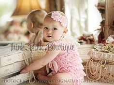 OMG I have to buy this for her its on etsy  http://www.etsy.com/listing/104795064/light-pink-petti-romper-pink-lace-petti#