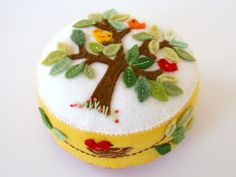 Wool felt pincushion with an appliquéd tree and by FabricAndInk