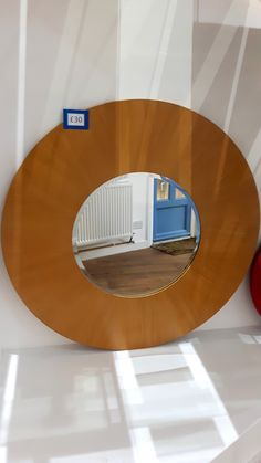 Wooden Mirror - £30 Description: Wooden frame with mirror in the centre. Size: 100cm diameter