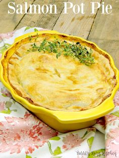 Salmon Pot Pie - Salmon, enveloped in a rich creamy broth, all covered in a light and flaky crust. Move over chicken pot pie, this salmon pot pie is going to take your place as the family favorite#SundaySupper  From www.bobbiskozykitchen.com