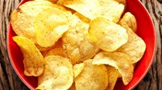 Potato chips are deep-fried, making this popular snack a greasy one. A serving of potato chips now and then isn't likely to harm your health, but eating them regularly could. Even reduced-fat versions pose a health risk when you eat them in large amounts. Snack Recipes, Cooking Recipes, Healthy Recipes, Snacks, Healthy Eats, Best Potato Chips, Snack Brands, Salty Foods, Love Food
