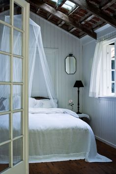 beautiful bedroom ... i love the skylight in the rafters