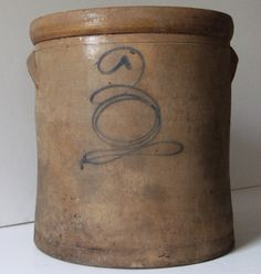 Antique crock with bee sting