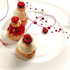 Profiteroles with Valrhona Opalys 33%, vanilla ice cream, choux, praline, white pearls and raspberry sorbet by Chef Sylvain Marrari
