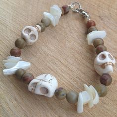 "Handmade ""Suzie Q"" Skull Bracelet Made with shell/stone beads. With silver clasp Handmade with stretchy string. From clasp to clasp about 7.5 inches in length. Price is firm unless bundled.  •Smoke Free Home •15% off bundles through PM feature or •Ask me the best I can do on a bundle!! •The more you bundle; the better the deal •Fast Shipping •Free Gift(s) over $10 purchase Jewelry Bracelets"