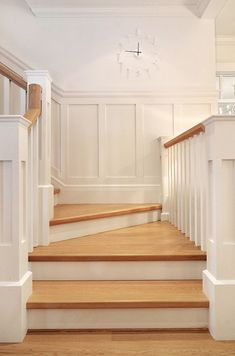 Staicase leading to upper level with built-in bookcase. Floors are white oak. Sunshine Coast Home Design.