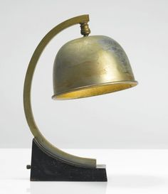Donald Deskey; Nickel-Plated Brass and Steel Table Lamp with Lacquered Wood Base for Deskey-Vollmer Inc., c1930.