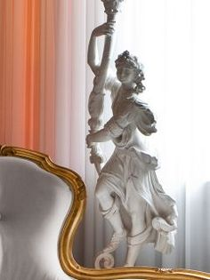 "Fabulous in any setting, the Louis XVIII Female figure candelabra. Carved from solid wood and shown here in our re interpreted finish of gold ""Pitti Oro"" or white finish. A true statement! French Chic, Lamp Shades, Furniture Collection, Luxury Furniture, Home Accessories, Solid Wood, Lanterns, Lamps, It Is Finished"