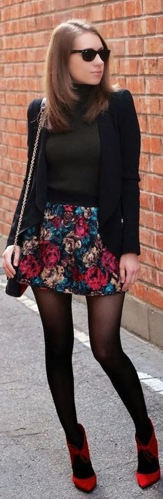 Shop this look on Lookastic:  http://lookastic.com/women/looks/sunglasses-pumps-tights-crossbody-bag-skater-skirt-blazer-turtleneck/6746  — Black Sunglasses  — Red Suede Pumps  — Black Tights  — Black Leather Crossbody Bag  — Navy Floral Skater Skirt  — Black Blazer  — Charcoal Turtleneck