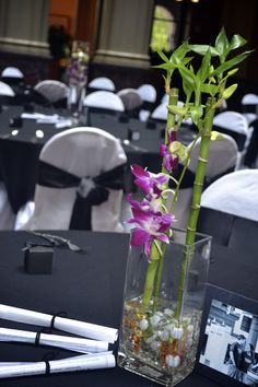 I could do these for about a dollar each.     Marah Cole Designs centerpieces with fuchsia orchids and bamboo / Asian theme wedding