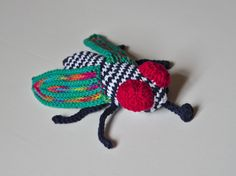 Inspiration: crochet FLY art - great use of leftovers