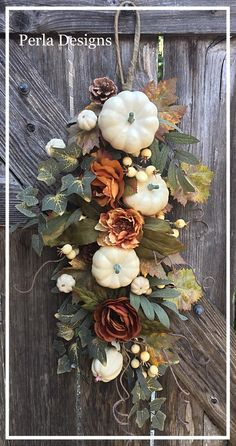 This is a long Fall Door Swag. It is made with gold yellow and rusty orange fall flowers, white pumpkins, pine cones and floral greenery. This swag can be hung on a door, sign, arbor or used as a centerpiece. Diy Fall Wreath, Fall Wreaths, Floral Wreaths, Thanksgiving Wreaths, Door Wreaths, Grapevine Wreath, Wooden Pumpkin Crafts, Fall Swags, Door Swag