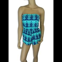 """Teal Aztec Print Romper #422-TM Teal Aztec print romper with pockets. 95% Rayon 5% Spandex. Made in U.S.A. Hand wash. Bust measured laying flat is 26"""" and it is elastic so it will stretch out 4"""" more. Waist 24"""" also elastic. Length 21"""". Always Me Pants Jumpsuits & Rompers"""