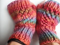 Handknit fingerless gloves in rainbow colors with lacy rib panels. $26.00, via Etsy.