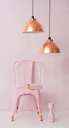 Pink chair and copper lights