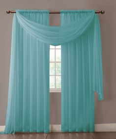 """Warm Home Designs extra wide Turquoise Blue curtains have total width of 112 inches. 2 panels (1 pair) is included in a package. Rod pocket insert will fit most rods up to 2"""" in diameter. Scarf length is 216"""". Both scarf and curtain sheers are made from high-quality polyester and are designed to let most of the sun light through while offering some privacy at night."""