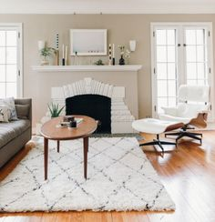 Living room – I love that the living room is airy and neutral – and then the entryway has the pop of color to add some energy and interest. Good taste and a little bit of vulgarity, right?