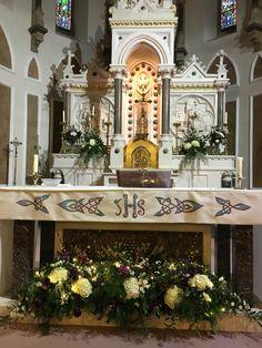 Church altar flowers by The Posy Barn