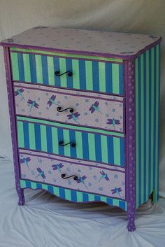 French Provincial dresser hand painted (no stencils ever used) in the colors of light\/dark purple, periwinkle blue,and blue-green. Swirls,