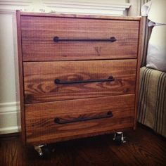 Stained ikea rast dresser with industrial wheels... and pipe pulls? Simple makeover for guest bedroom's industrial vibe.