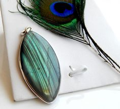 Check out this item in my Etsy shop https://www.etsy.com/uk/listing/545222050/genuine-labradorite-pendant-natural