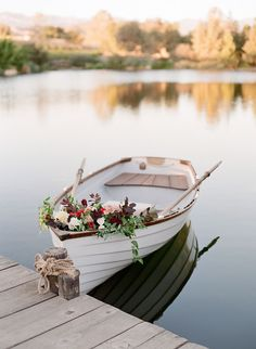 floral decorated row boat | Photography: Lacie Hansen