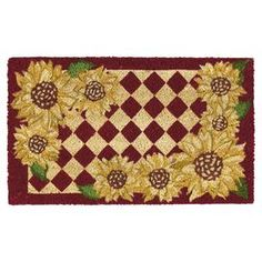 """Natural coir doormat with sunflower and checker motif.  Product: DoormatConstruction Material: Coir and vinylColor: Red, yellow and greenFeatures: Sunflower designDimensions: 18"""" H x 30"""" W Cleaning and Care: Shake briskly to clean"""